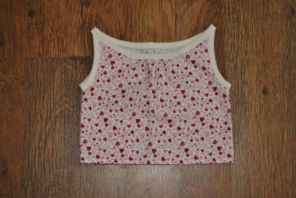 "Cotton boat-necked heart print top edged in white jersey. Chest size 20/21"", approximately 1-2 years. £8 + p&p."