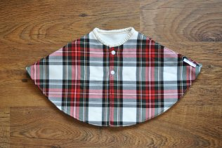 Unisex fleece lined tartan cape. Secures at the front with two plastic snappers. Size 0-1 year. £24 + p&p.