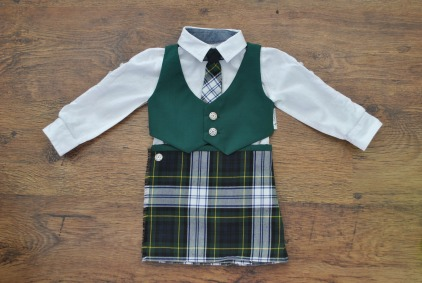 Deluxe kilt package with kilt, waistcoat, and matching tie. Also available are flashes and garters (not pictured). The complete set of kilt, waistcoat, tie and flashes is available for 0 to 3 years. 0-12 months: £45, 12-24 months £48, 2-3 years £50, all plus p&p. Please contact me for a quote if you would like a kilt outfit for an older child, or a particular fabric choice.